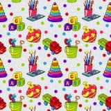 Teste padrão sem emenda com os brinquedos das crianças coloridas Imagens de Stock Royalty Free