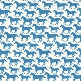 Teste padrão sem emenda com os cavalos estilizados da silhueta Fotografia de Stock Royalty Free