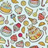 Teste padrão sem emenda com os doces no fundo azul Imagem de Stock Royalty Free