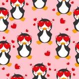 Teste padrão sem emenda com pinguim dos desenhos animados em um fundo cor-de-rosa Imagem de Stock Royalty Free
