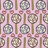 Teste padrão sem emenda com pirulitos e corações no fundo violeta pontilhado Foto de Stock Royalty Free