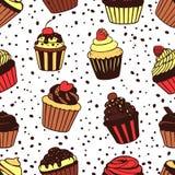 Teste padrão sem emenda com queques doces Imagens de Stock