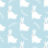 Teste padrão sem emenda da lebre Coelho pequeno bonito em um fundo azul Projeto bonito do coelho para a tela e a decoração ilustração do vetor