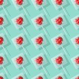 Teste padrão sem emenda dado forma coração dos pirulitos do Valentim ilustração stock