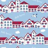 Teste padrão sem emenda das casas e das nuvens brancas Foto de Stock Royalty Free