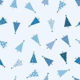 Teste padrão sem emenda do Natal com as árvores de Natal na luz - vagabundos azuis Fotos de Stock