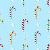 Teste padrão sem emenda do Natal com doces e flocos de neve no fundo azul ilustração royalty free