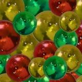 Teste padrão sem emenda do vetor: Bolas de brilho: Cores douradas, vermelhas e verdes ilustração do vetor