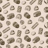 Teste padrão sem emenda do vetor com chocolates ilustração royalty free