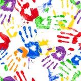 Teste padrão sem emenda do vetor com handprints da pintura Fotos de Stock Royalty Free