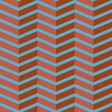 Teste padrão sem emenda do vetor da viga Ziguezague colorido do vermelho de tijolo no fundo dos azul-céu Fotos de Stock