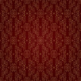 Teste padrão sem emenda do vintage floral do ouro em um fundo vermelho Foto de Stock