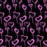 Teste padrão sem emenda dos pirulitos na forma de corações cor-de-rosa em um fundo preto ilustração royalty free