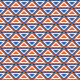 Teste padrão sem emenda geométrico com triângulos vermelho-azuis Imagem de Stock
