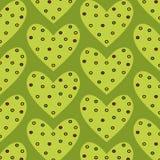 Teste padrão sem emenda pontilhado do coração verde em um fundo verde Fotografia de Stock Royalty Free