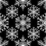 Teste padrão sem emenda simples com os flocos de neve no fundo preto ilustração stock
