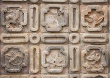 Teste padrão simbólico na parede Foto de Stock Royalty Free