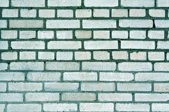 Teste padrão sujo tonificado ciano da parede de tijolo imagem de stock