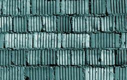 Teste padrão sujo tonificado ciano da parede de tijolo fotos de stock royalty free