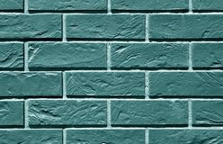 teste padrão tonificado ciano da parede de tijolo fotografia de stock