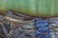 Teste padrão três das calças de brim no quadro Fotografia de Stock