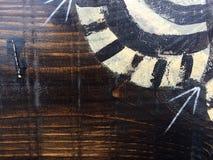 Teste padrão tribal pintado na textura de madeira imagens de stock