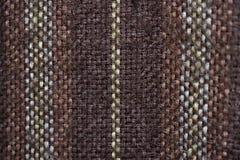 Teste padrão velho de matéria têxtil de Brown fotografia de stock