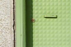 Teste padrão verde pintado da porta foto de stock