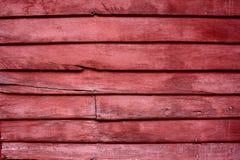 Teste padrão vermelho de madeira da parede fotos de stock