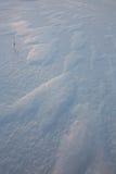 Teste padrão Windblown da neve Fotografia de Stock