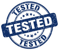Tested blue grunge round stamp. Tested blue grunge round vintage rubber stamp Stock Photos