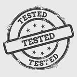 Tested rubber stamp isolated on white background. Royalty Free Stock Image