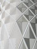 Testes padrões brancos e revestimento do diamante geométrico na parede de um moder Fotos de Stock Royalty Free