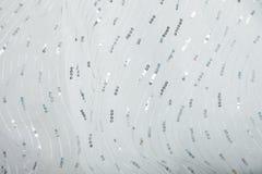Testes padrões brilhantes em um vestido de casamento branco ilustração stock