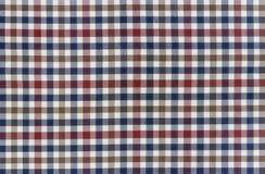 Testes padrões da manta em azuis marinhos vermelhos, escuros, e em branco Fotografia de Stock Royalty Free