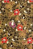 Testes padrões de flores elegantes na tela de seda tailandesa Fotos de Stock