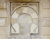 Testes padrões decorativos na parede de pedra Imagem de Stock