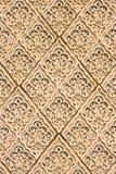 Testes padrões do leste em uma parede foto de stock