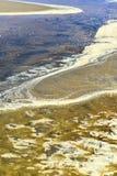 Testes padrões, goivaduras em dunas de areia, sulcos e ilha imagem de stock royalty free