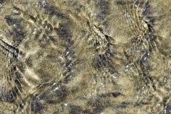 Testes padrões molhados abstratos da areia imagem de stock