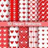 10 testes padrões sem emenda do vetor do coração Cores vermelhas e brancas Ilustração Stock