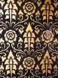 Testes padrões tailandeses da escrita no templo da parede Imagem de Stock