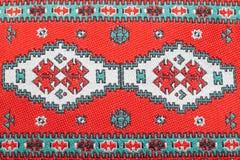 Testes padrões vermelhos do bordado Fotografia de Stock Royalty Free