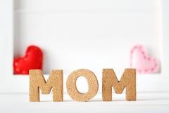 Testi di Cork Mom con i cuscini del cuore fotografia stock libera da diritti