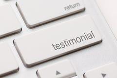 Testimonial on Return key. Testimonial button key on white keyboard Stock Photo