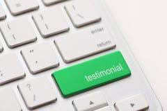 Testimonial on Return key. Testimonial button key on white keyboard Stock Images