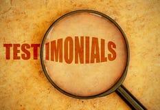 Testimonials. Magnifying glass focused on testimonials Stock Image
