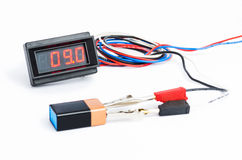 Testing battery with digital voltmeter Royalty Free Stock Image