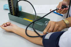 Testing blood pressure. Stock Images