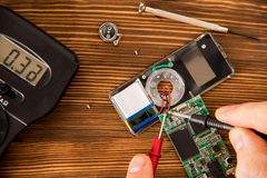 Testing the chip for service by means of a tester and a set of electronics engineer. Radioelectronic Testing Set for soldering wire and shrink soldering tube Royalty Free Stock Photography